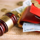 Gavel-and-money-coins-on-woode-66763165